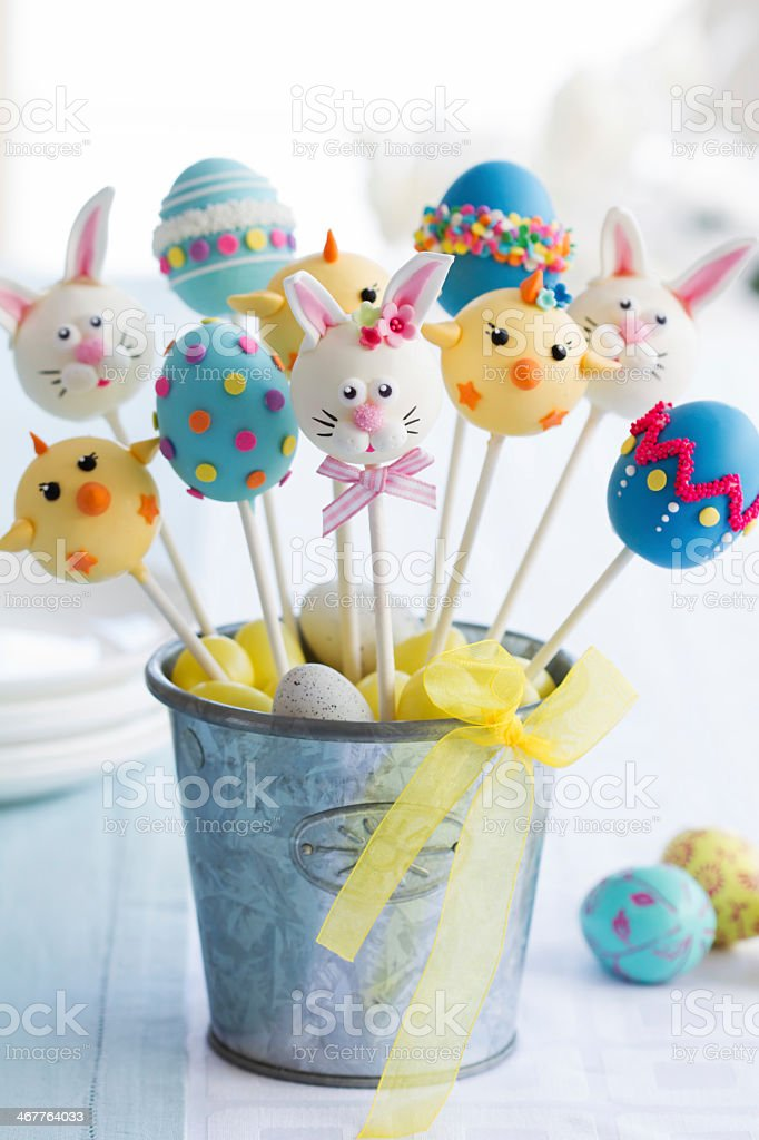 Colorful Easter cake pops with faces and designs stock photo