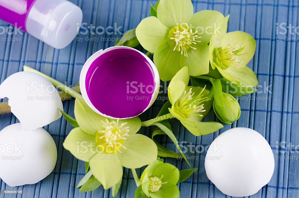 Colorful Easter decoration with egg shell filled with magenta tempera stock photo