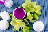 Colorful Easter decoration with egg shell filled with magenta tempera
