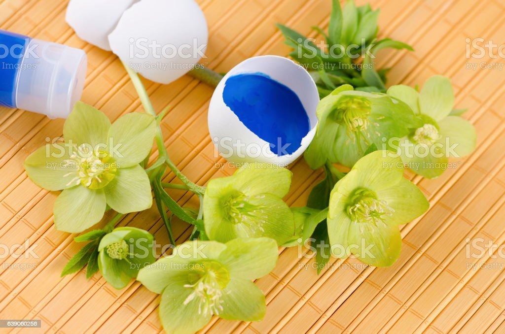 Colorful Easter decoration with egg shells and on a yellow stock photo