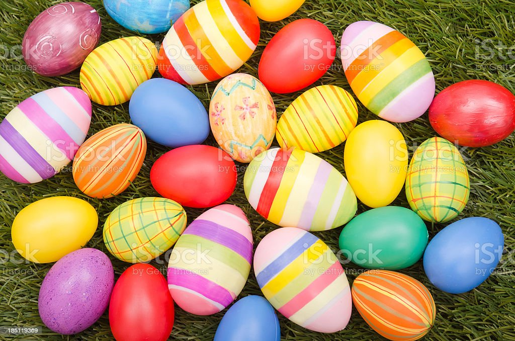 Colorful easter egg on grass stock photo