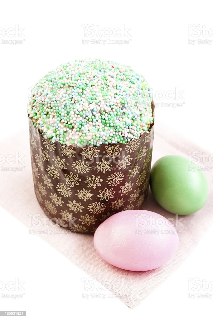 Colorful Easter eggs and cake on white  background, spring holid stock photo