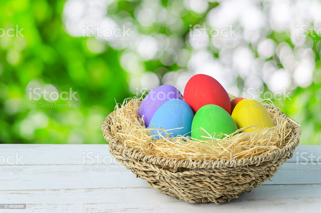 Colorful easter eggs at brown nest stock photo