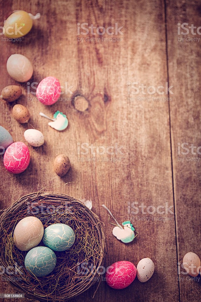 Colorful Easter Eggs Decoration on Wooden Background stock photo