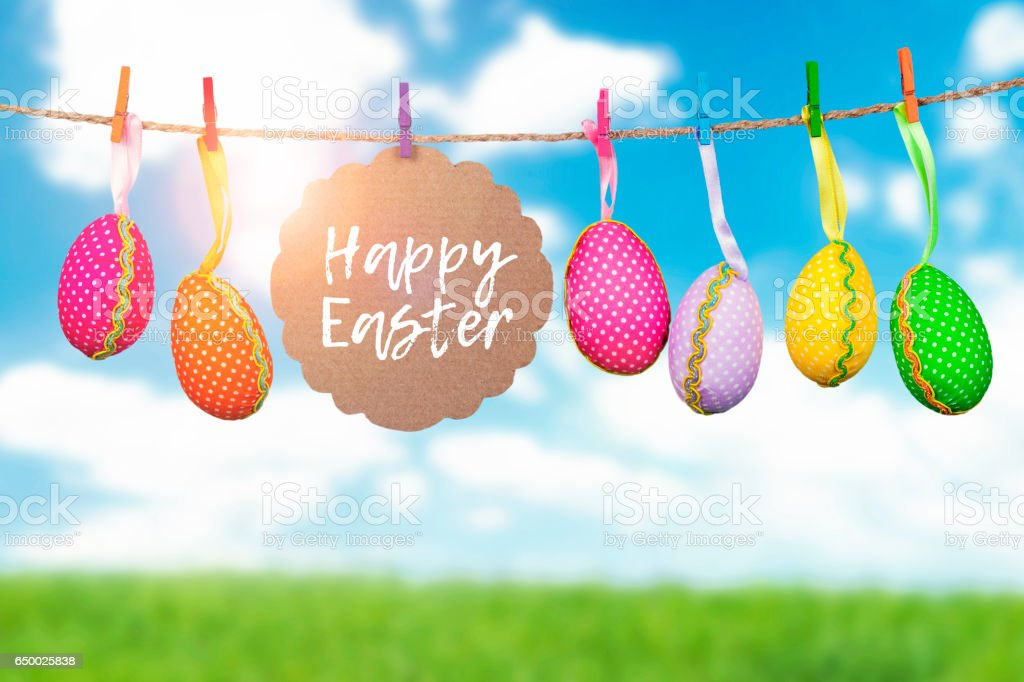 Colorful easter eggs hanging on a rope outside. stock photo