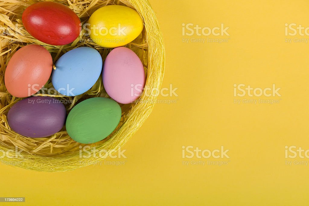 Colorful Easter Eggs in a basket royalty-free stock photo