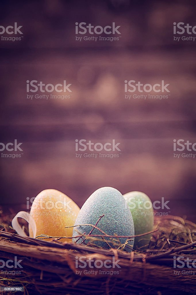 Colorful Easter Eggs in a Basket stock photo
