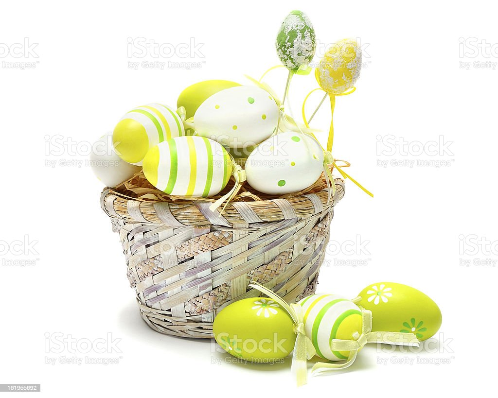 colorful easter eggs in basket royalty-free stock photo
