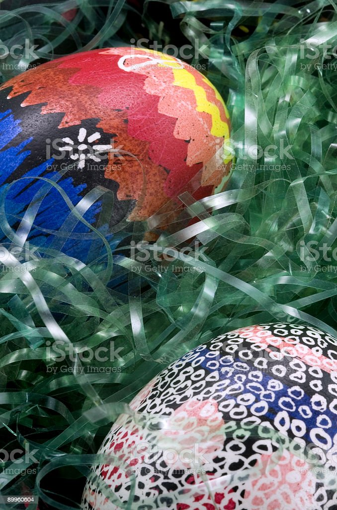 Colorful Easter Eggs in Grass - Wavy Design at Top royalty-free stock photo