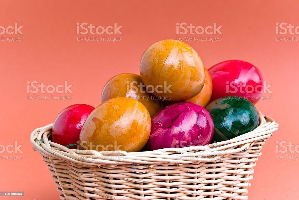 colorful easter eggs in red basket royalty-free stock photo