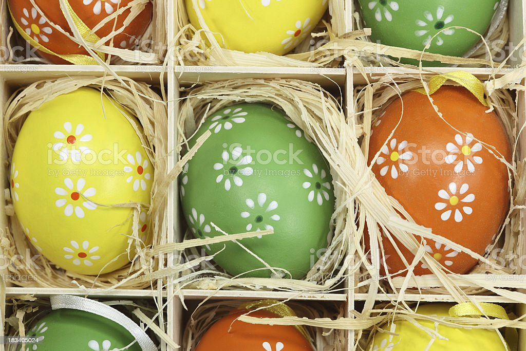 colorful easter eggs in straw royalty-free stock photo
