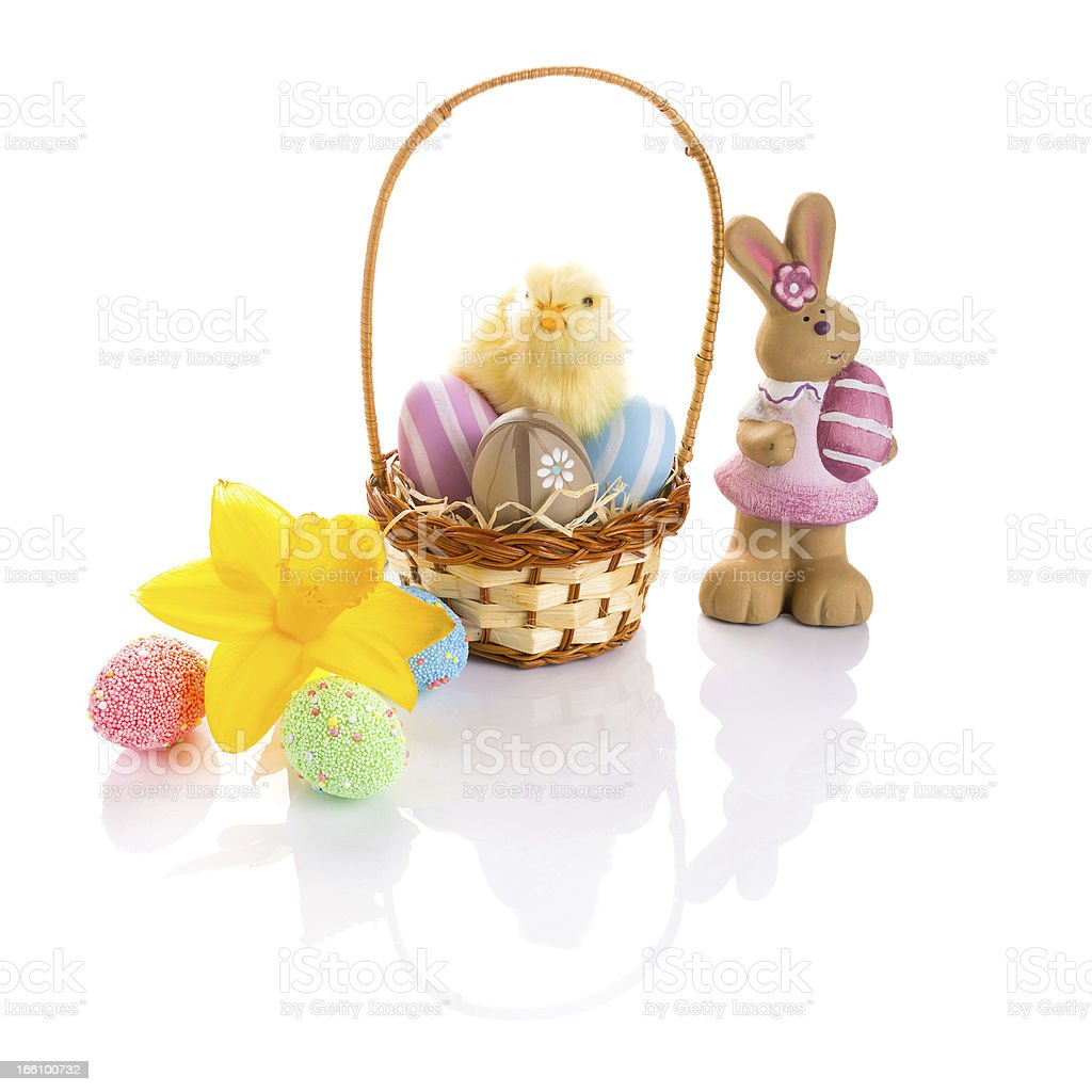 Colorful Easter eggs in the basket and decorations royalty-free stock photo