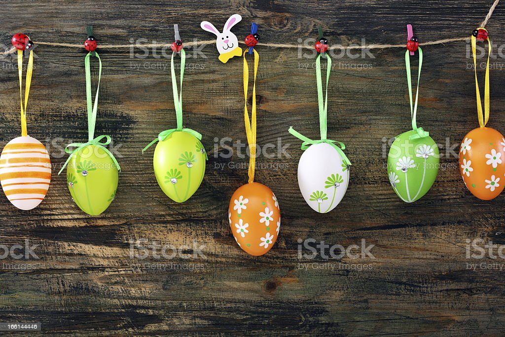 Colorful Easter eggs on a fun clothespins. royalty-free stock photo