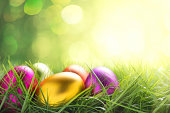 Colorful easter eggs on illuminated background with copy space