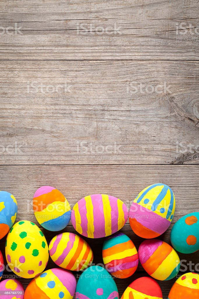 Colorful easter eggs on old wooden table stock photo
