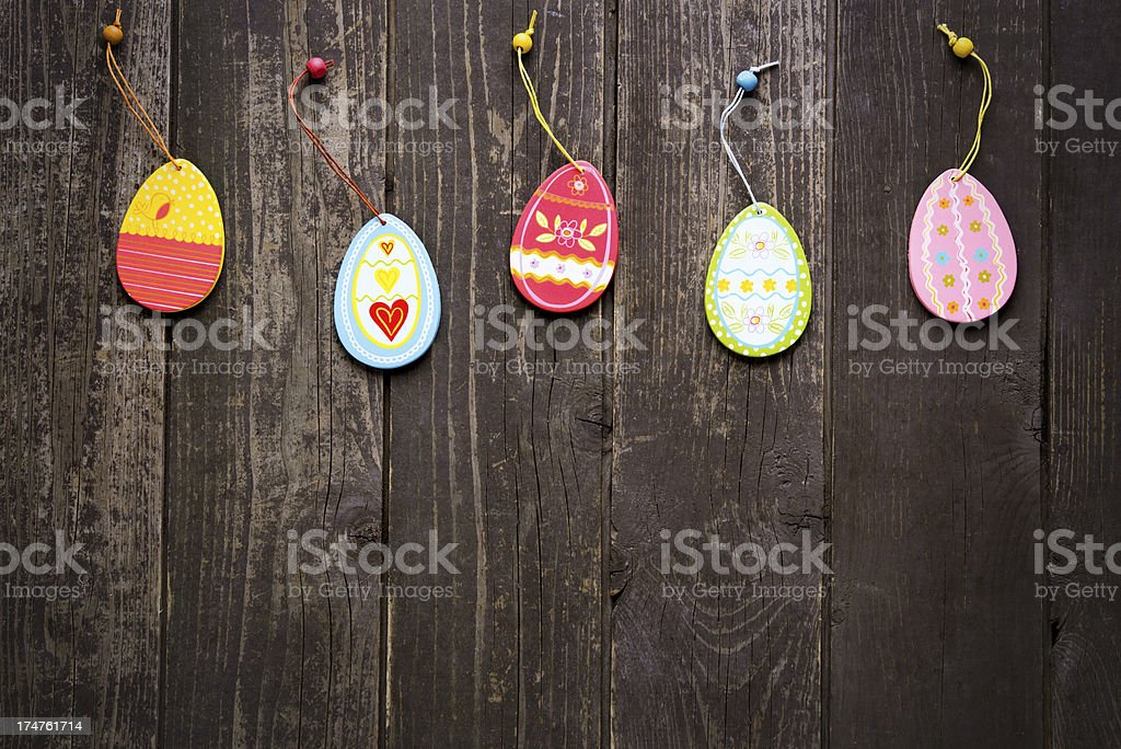 Colorful Easter Eggs on rustic wood royalty-free stock photo