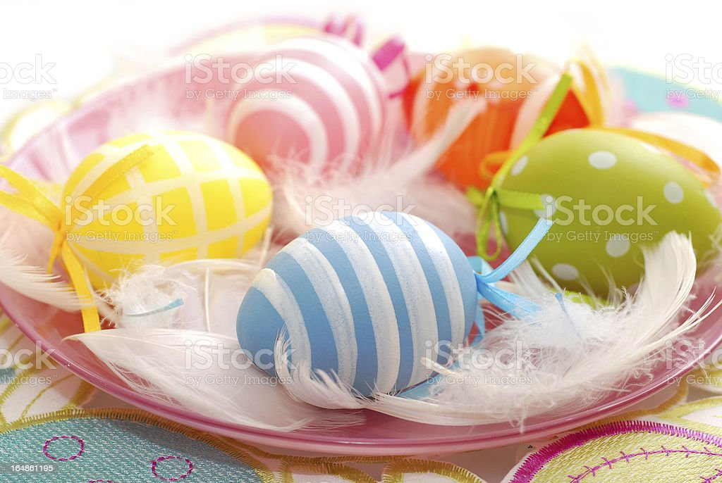 colorful easter eggs on the plate royalty-free stock photo
