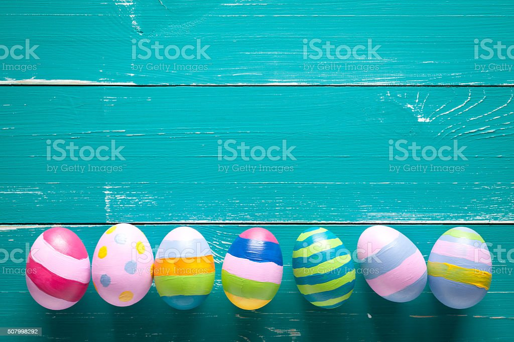 Colorful easter eggs on turquoise wooden table stock photo