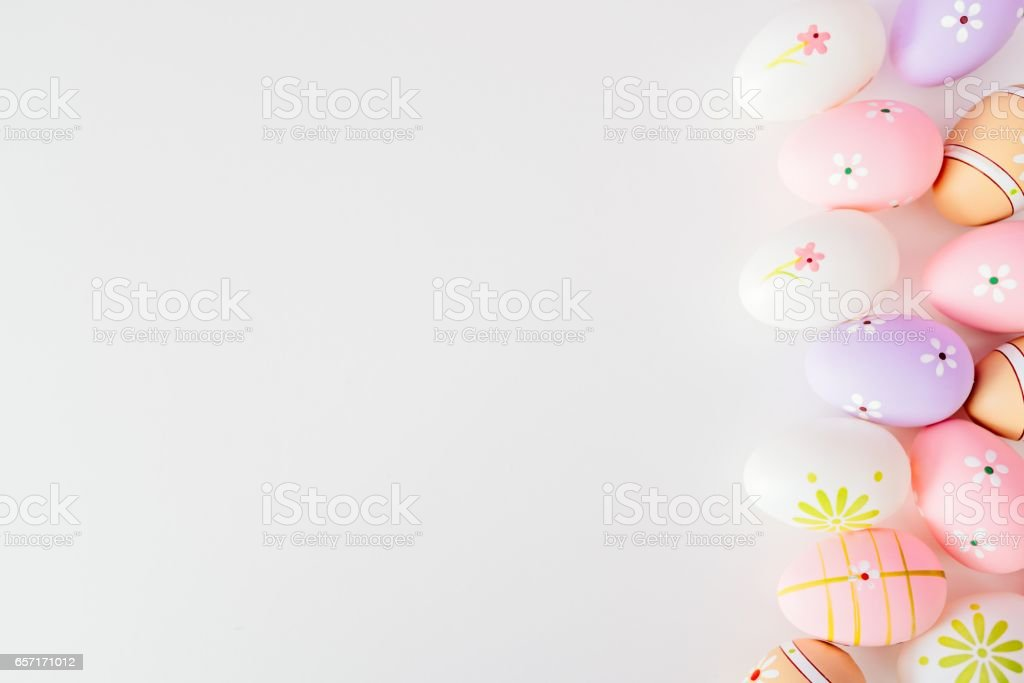 Colorful Easter eggs on white background with space for message stock photo