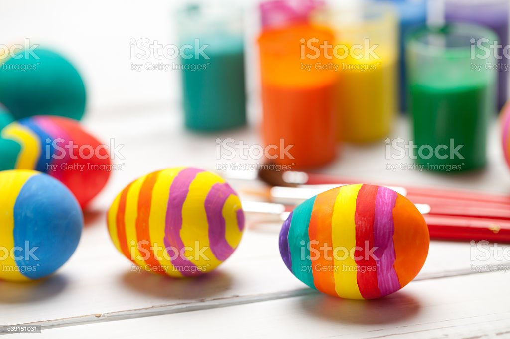Colorful easter eggs on white table stock photo