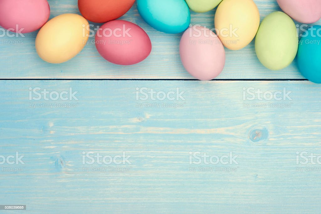 Colorful easter eggs on wooden plank stock photo