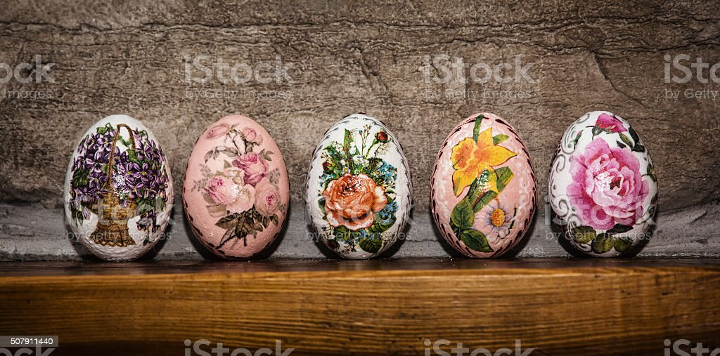 Colorful Easter eggs stacked on the wooden base, Easter holiday stock photo