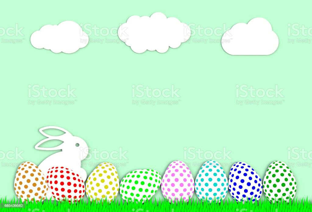 Colorful easter eggs with grass isolated on green background, paper art and craft style. stock photo
