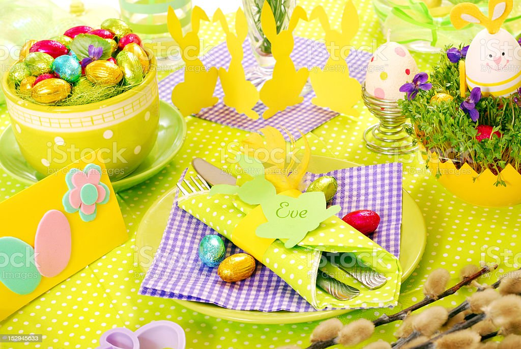 Colorful Easter table decorations and place setting  stock photo
