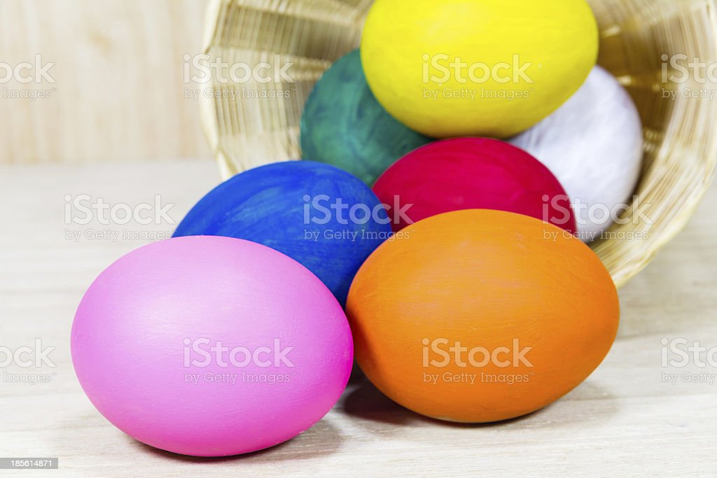 Colorful eggs in basket royalty-free stock photo