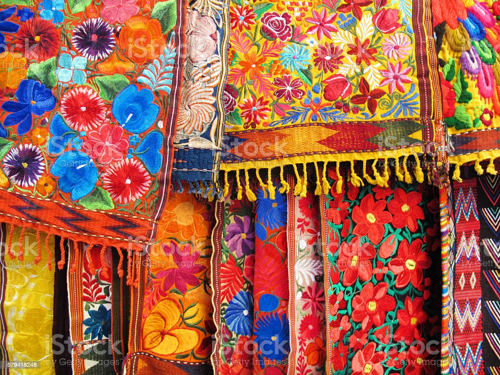 Colorful Embroidered Fabrics in an Outdoor Market in Mexico stock photo