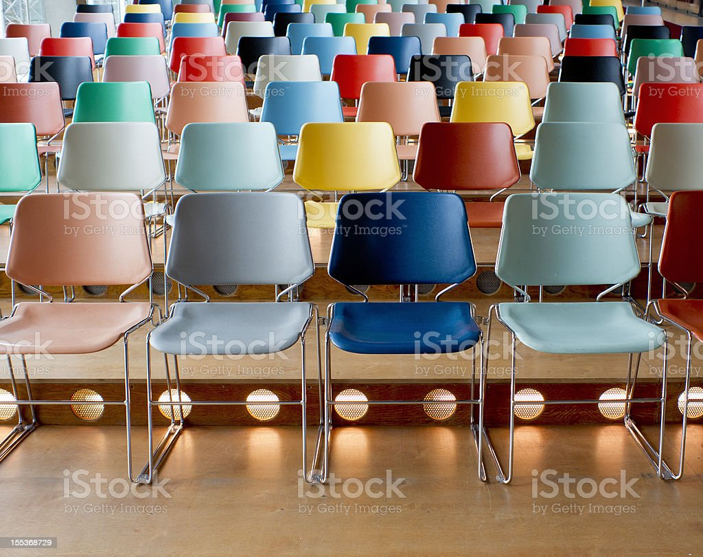 colorful empty chairs in theater stock photo