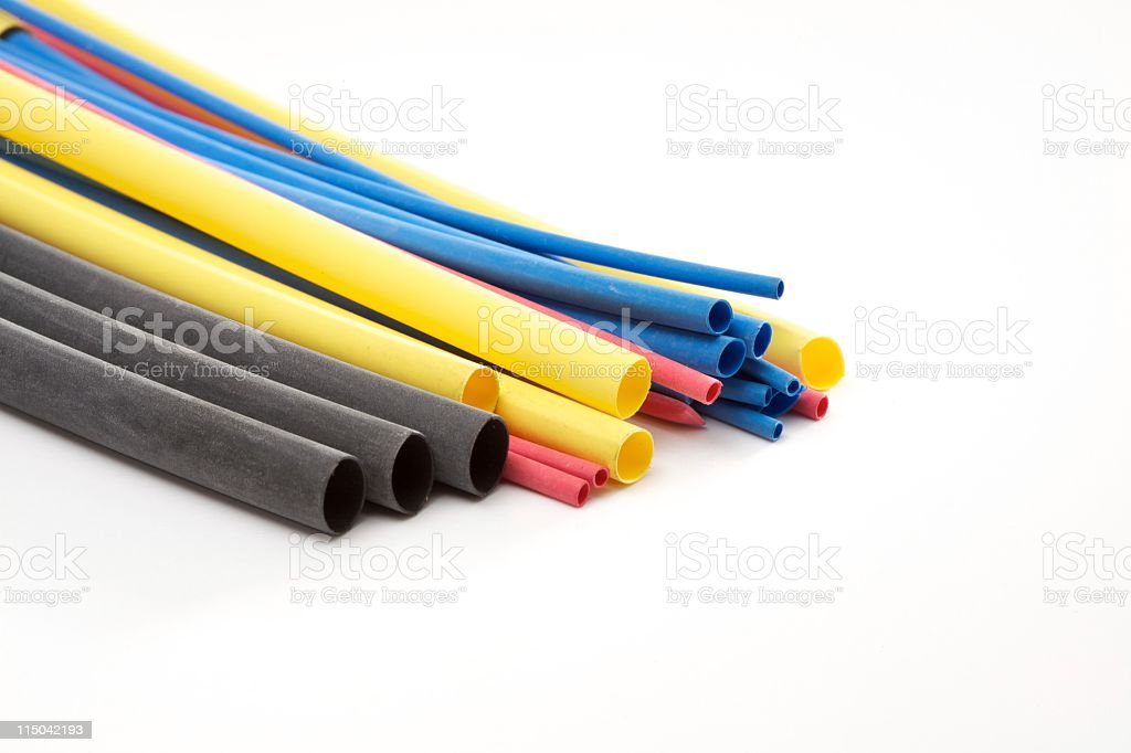Colorful ends of assorted pipes on white background stock photo