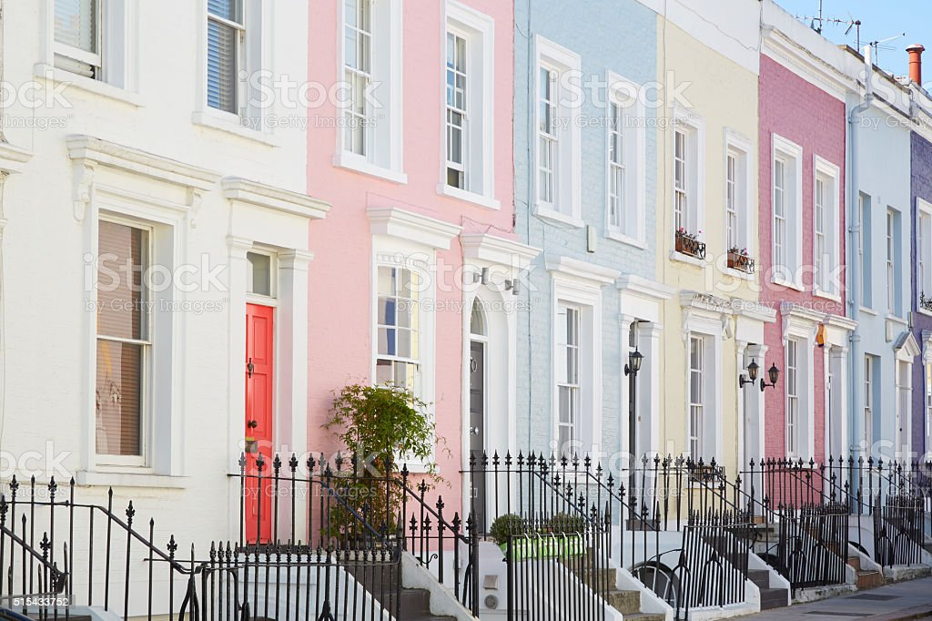 Colorful English houses facades, pastel pale colors in London stock photo