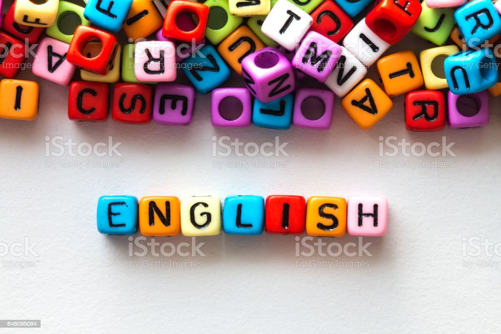 colorful english word cube on white paper background stock photo
