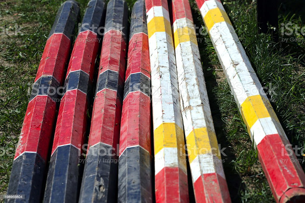 Colorful equitation obstacles bars for horse jumping event stock photo