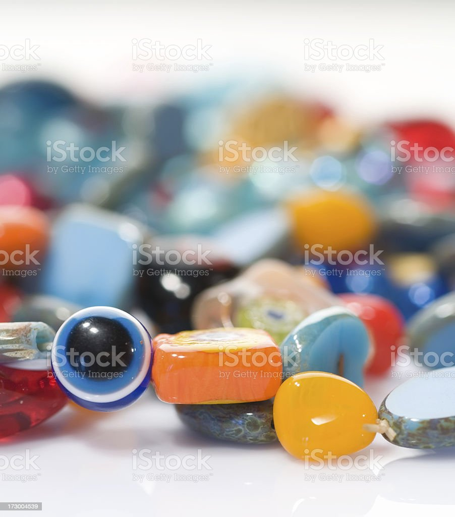 Colorful ethnic beads with evil eye. stock photo