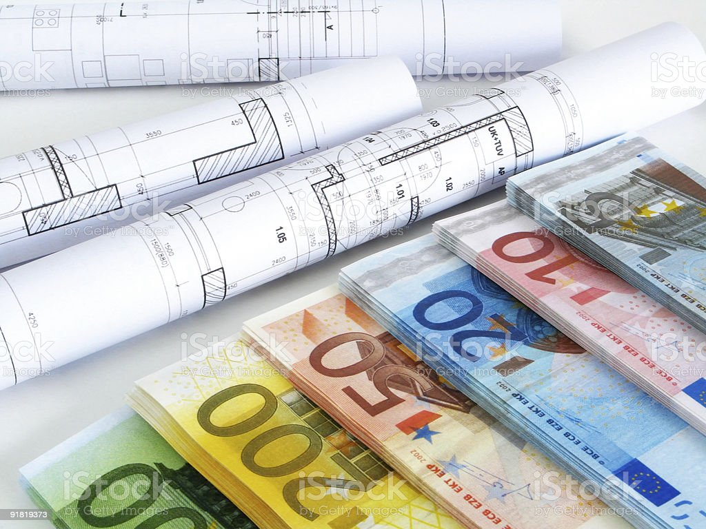 Colorful euro notes and plans in background royalty-free stock photo