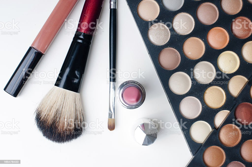 colorful eyeshadows, lipstick and makeup brushes royalty-free stock photo
