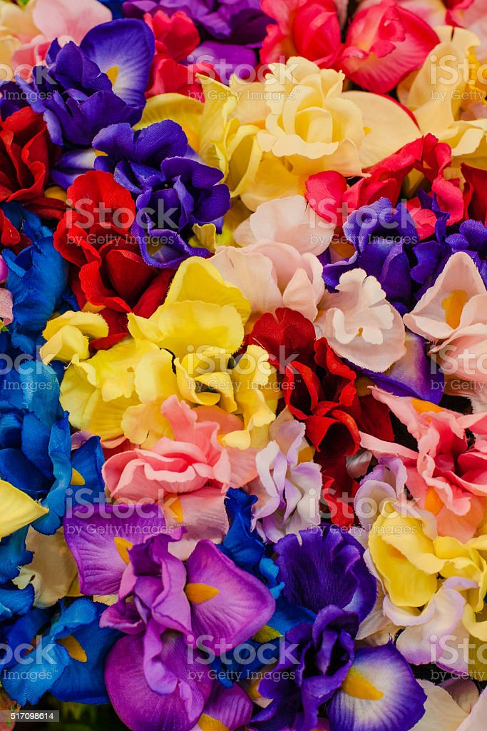 Colorful fabric flowers background stock photo