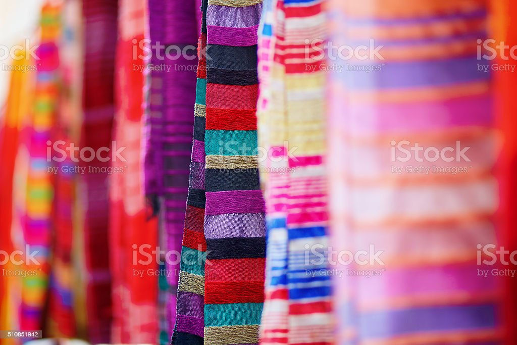 Colorful fabrics and carpets for sale in Essaouira stock photo
