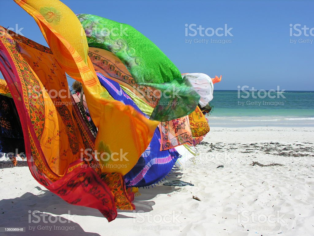 Colorful fabrics blowing in the wind stock photo