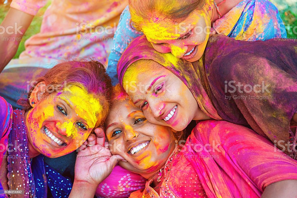 Colorful Faces Holi Festival Indian Girls Celebrating Festival of Colors stock photo