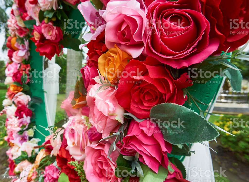 Colorful faked roses for decoration. stock photo