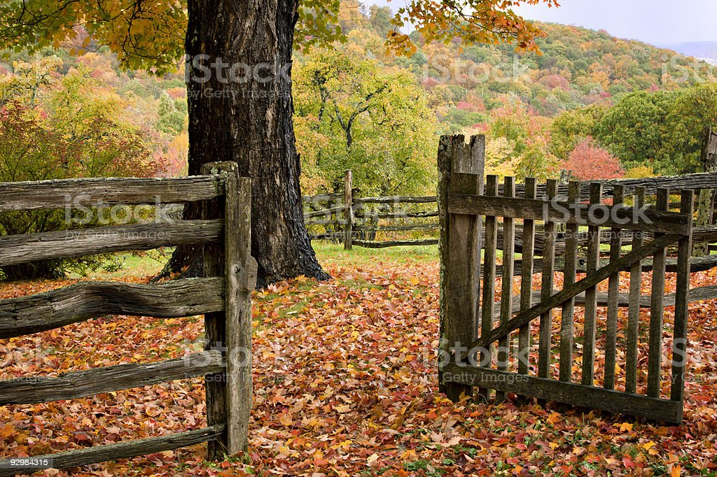 Colorful Fall fence, mountains and gate royalty-free stock photo