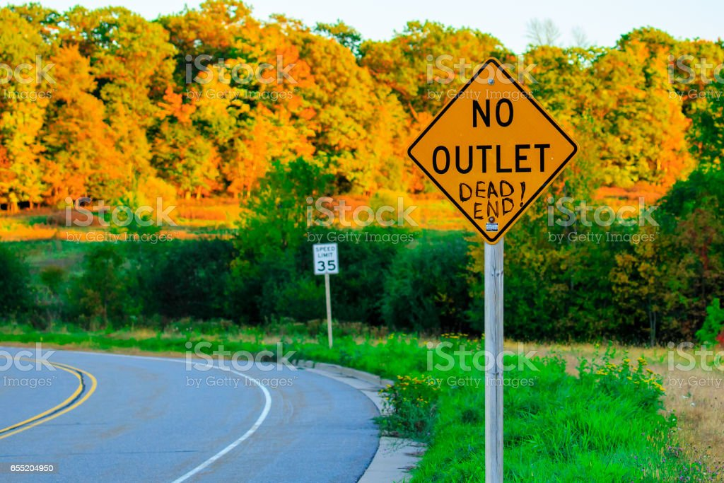 Colorful fall trees with a no outlet sign stock photo