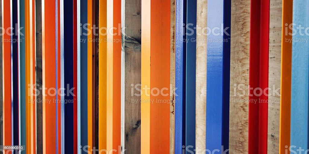 Colorful fence. Repeated wooden blocks. Aged photo stock photo