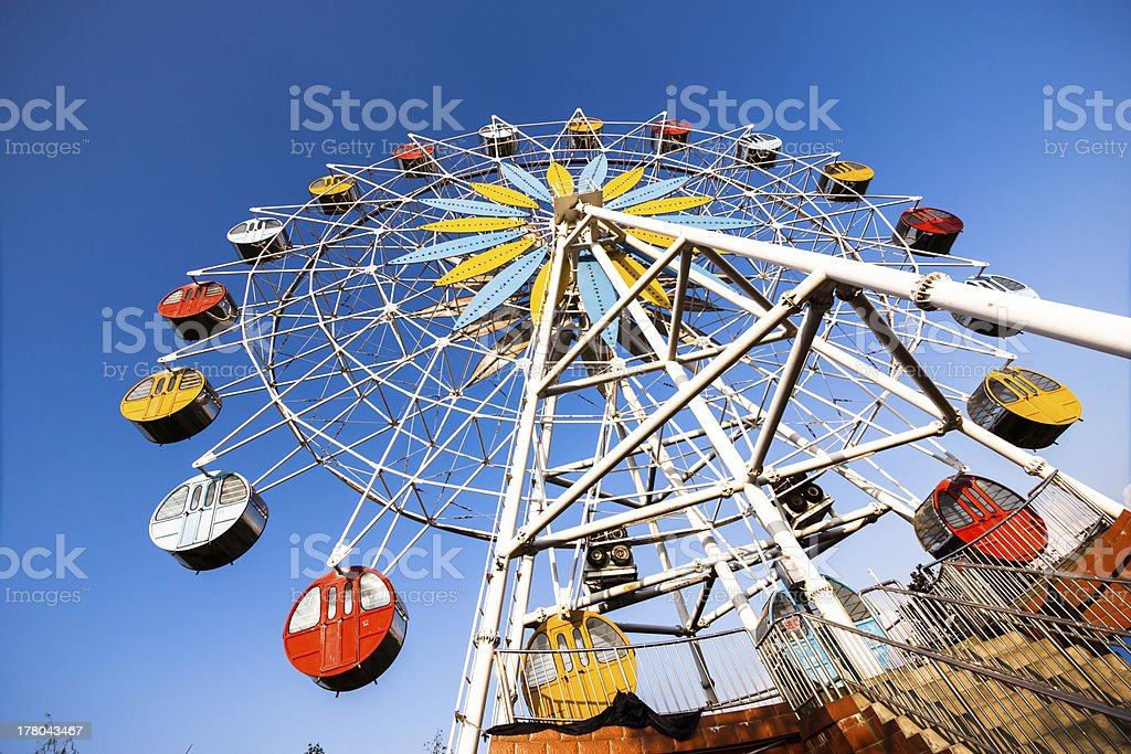 Colorful ferris wheel and blue sky stock photo