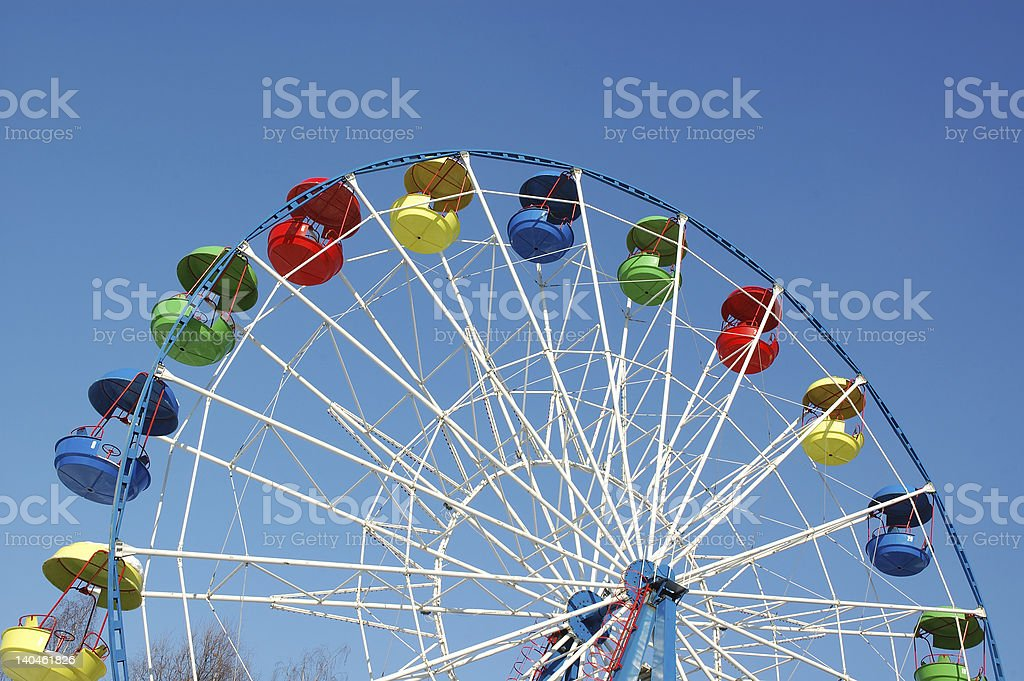 A colorful ferris wheel on a blue sky royalty-free stock photo
