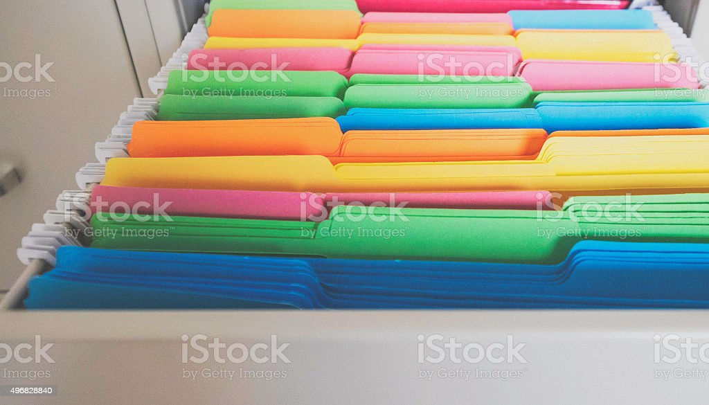 Colorful file folders in file cabinet drawer stock photo