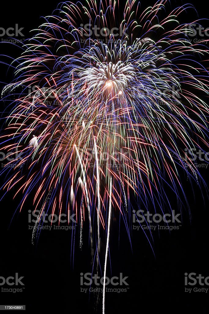 Colorful fireworks against the dark sky stock photo
